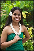 Tahitian woman making the traditional welcome gesture. Polynesian Cultural Center, Oahu island, Hawaii, USA