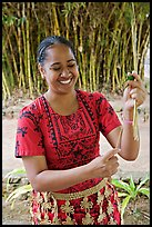 Tonga woman showing how to make cloth out of Mulberry bark. Polynesian Cultural Center, Oahu island, Hawaii, USA