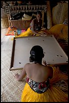 Fiji women playing a traditional game similar to pool. Polynesian Cultural Center, Oahu island, Hawaii, USA