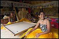 Fiji women sitting at a traditional pool table in vale ni bose (meeting) house. Polynesian Cultural Center, Oahu island, Hawaii, USA (color)