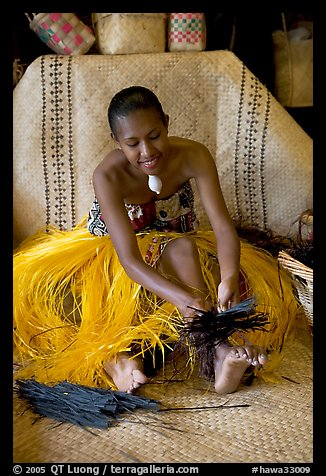Fiji woman using her feet to tie leaves. Polynesian Cultural Center, Oahu island, Hawaii, USA (color)