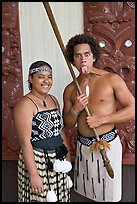 Maori woman and man sticking out his tongue. Polynesian Cultural Center, Oahu island, Hawaii, USA