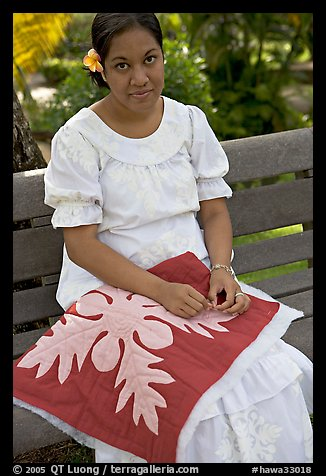 Woman making a traditional hawaiian quilt. Polynesian Cultural Center, Oahu island, Hawaii, USA (color)