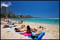 Young women sunning on Waikiki Beach. Waikiki, Honolulu, Oahu island, Hawaii, USA