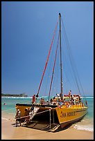 Catamaran landing on Waikiki Beach. Waikiki, Honolulu, Oahu island, Hawaii, USA (color)