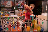 Woman preparing a cup of shave ice. Waikiki, Honolulu, Oahu island, Hawaii, USA (color)