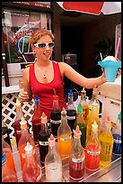 Woman handing out a cup of shave ice. Waikiki, Honolulu, Oahu island, Hawaii, USA