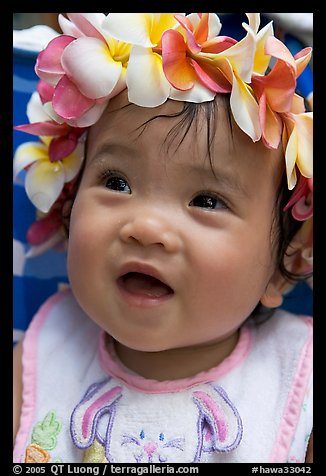 Baby girl wearing a flower lei on her head. Waikiki, Honolulu, Oahu island, Hawaii, USA (color)