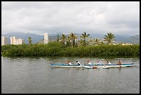 Outrigger canoe along the Ala Wai Canal. Waikiki, Honolulu, Oahu island, Hawaii, USA (color)