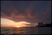 Sun setting and Honolulu skyline. Waikiki, Honolulu, Oahu island, Hawaii, USA (color)