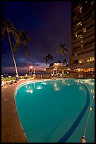 Swimming pool at night, with dance performance, Sheraton hotel. Waikiki, Honolulu, Oahu island, Hawaii, USA (color)