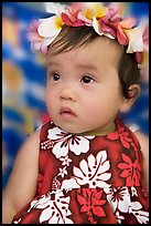 Baby girl in hawaiian dress wearing a flower lei on her head. Waikiki, Honolulu, Oahu island, Hawaii, USA ( color)