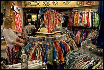 Woman shopping hawaiian dresses. Waikiki, Honolulu, Oahu island, Hawaii, USA