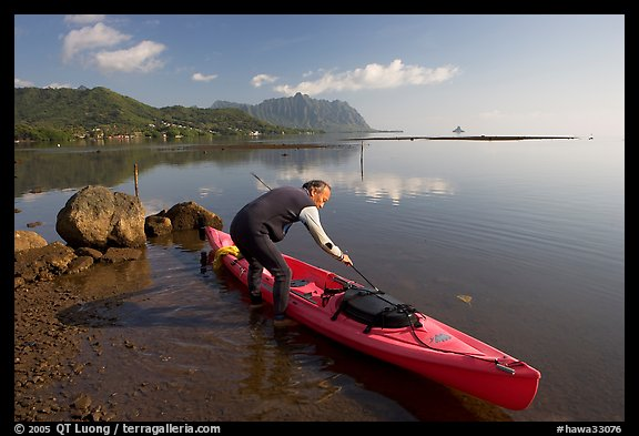 Picture photo man loading sea kayak for a fishing trip for Kayak fishing hawaii