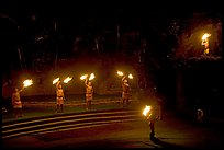 Dance with fire performed by Samoans. Polynesian Cultural Center, Oahu island, Hawaii, USA (color)
