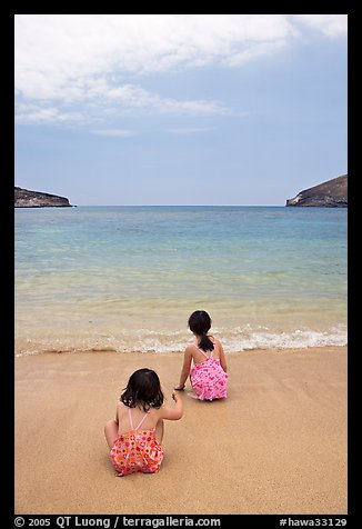 Two girls at the edge of water, Hanauma Bay. Oahu island, Hawaii, USA (color)
