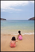 Two girls at the edge of water, Hanauma Bay. Oahu island, Hawaii, USA