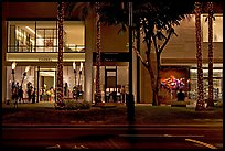 Shopping section of Kalakaua avenue at night. Waikiki, Honolulu, Oahu island, Hawaii, USA (color)