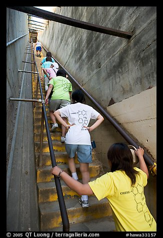 Women climbing a staircase on the Diamond Head summit trail. Oahu island, Hawaii, USA (color)