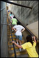 Women climbing a staircase on the Diamond Head summit trail. Oahu island, Hawaii, USA