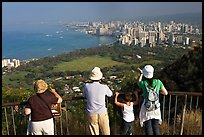 Tourists look at Waikidi from the  Diamond Head crater, early morning. Oahu island, Hawaii, USA (color)