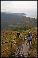 Visitors take a photo on the last steps of the Diamond Head crater summit trail. Oahu island, Hawaii, USA