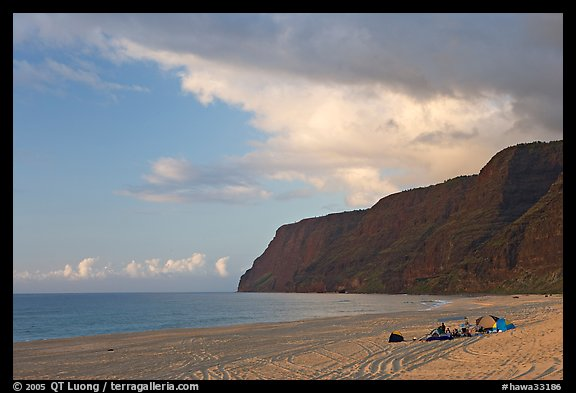 Campers and tire tracks in the sand, Polihale Beach, sunset. Kauai island, Hawaii, USA (color)