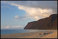 Campers and tire tracks in the sand, Polihale Beach, sunset. Kauai island, Hawaii, USA