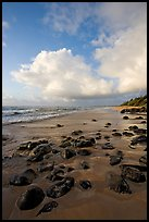Boulders, coastline, and clouds, Lydgate Park, sunrise. Kauai island, Hawaii, USA ( color)