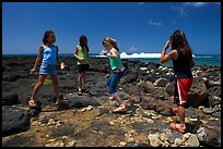 Girls playing in tidepool, Kukuila. Kauai island, Hawaii, USA ( color)