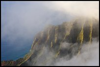 Fluted ridges seen through clouds, Kalalau lookout, late afternoon. Kauai island, Hawaii, USA