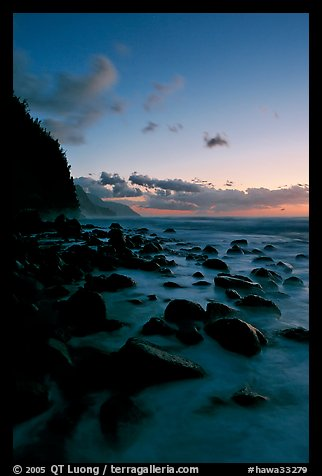 Boulders and misty surf from Kee Beach, dusk. Kauai island, Hawaii, USA (color)