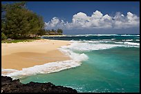Beach and  turquoise waters, and homes  near Haena. North shore, Kauai island, Hawaii, USA ( color)