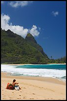 Woman sitting on a beach chair on Tunnels Beach. North shore, Kauai island, Hawaii, USA