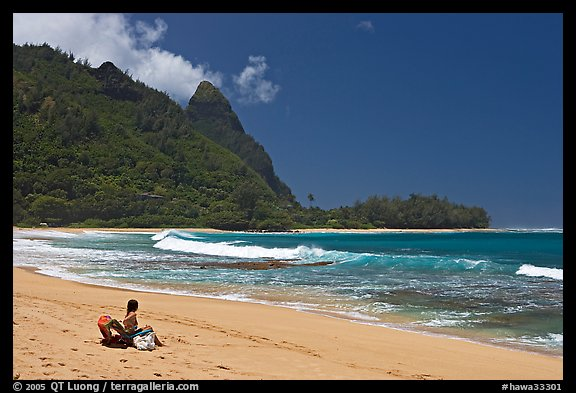 Woman sitting on a beach chair on Makua (Tunnels) Beach. North shore, Kauai island, Hawaii, USA (color)