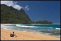 Woman sitting on a beach chair on Makua (Tunnels) Beach. North shore, Kauai island, Hawaii, USA