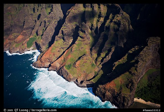 Aerial view of fluted mountains and surf, Na Pali Coast. Kauai island, Hawaii, USA