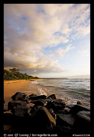 Boulders and beach, Lydgate Park, sunrise. Kauai island, Hawaii, USA