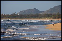 Woman with child on beach, Lydgate Park, early morning. Kauai island, Hawaii, USA