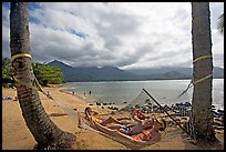 Family on Hammock with Hanalei Bay in the background. Kauai island, Hawaii, USA