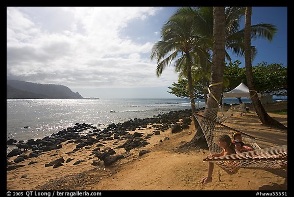 Family on Hammock, Puu Poa Beach. Kauai island, Hawaii, USA (color)