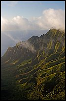 Lush Hills above Kalalau Valley and clouds, late afternoon. Kauai island, Hawaii, USA