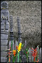 Flowers offered to Polynesian idols, Place of Refuge. Big Island, Hawaii, USA (color)