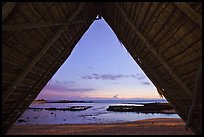 Aiopio fishtrap framed by Halau at dusk, Kaloko-Honokohau National Historical Park. Hawaii, USA