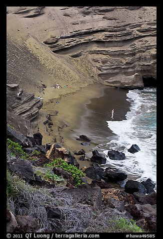 Beachgoers and green sand beach near South Point. Big Island, Hawaii, USA