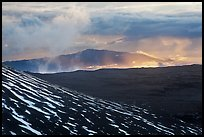 Volcanic mountains and clouds at sunset. Mauna Kea, Big Island, Hawaii, USA (color)