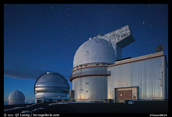 Telescopes and stars at nightfall. Mauna Kea, Big Island, Hawaii, USA