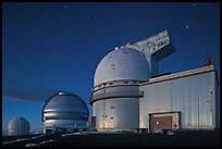 Telescopes and stars at nightfall. Mauna Kea, Big Island, Hawaii, USA (color)