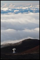 Astronomic radio antenna and sea of clouds. Mauna Kea, Big Island, Hawaii, USA (color)