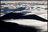Dark ridges and clouds from above. Mauna Kea, Big Island, Hawaii, USA (color)